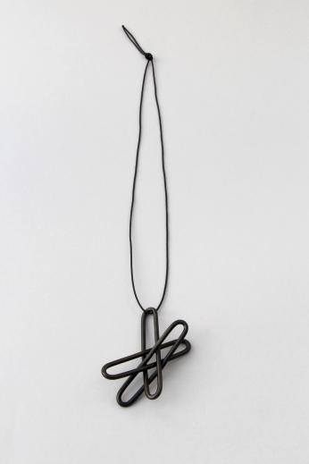 Debbie Adamson. Staples pendant. Steel, zinc, synthetic thread. 2015